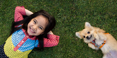 kids and dog on lawn